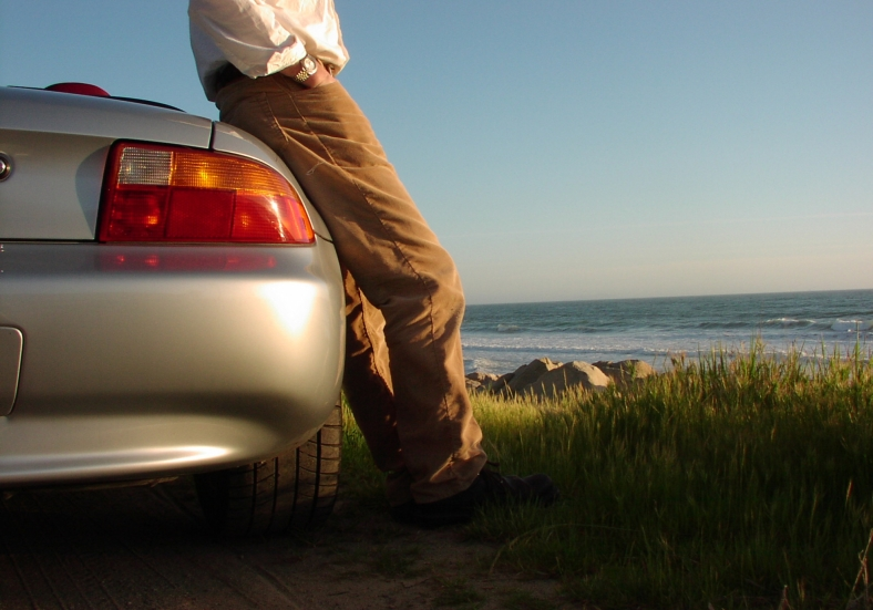 man standing by car